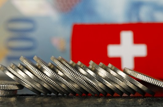 Swiss Flag and Swiss Francs